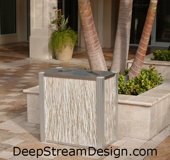 DeepStream's Modern Combination Trash and Recycling Bin with 3form Bear Grass panels under cover at an outdoor mall