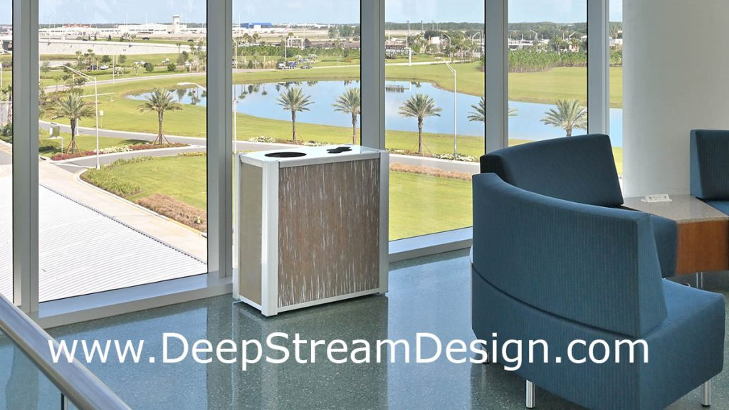 DeepStream modern combination trash and recycling receptacle in an airport lounge with windows