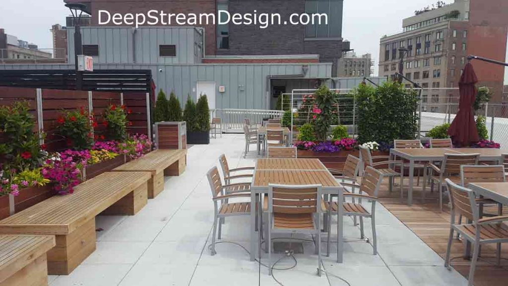 See more examples of wood planter anchored screen walls on DeepStream's solutions website