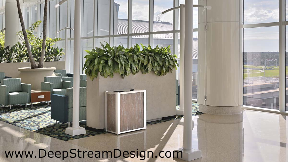 DeepStream modern combination recycling receptacle and trash bin with 3form Varia Thatch resin panels in an airport lounge in front of a planter