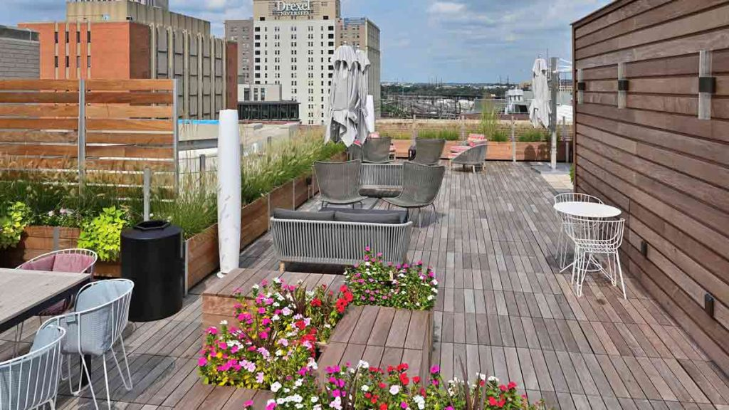 s Multi-Section Commercial Planters anchor integrated wood and glass privacy screen wall on a urban roof deck